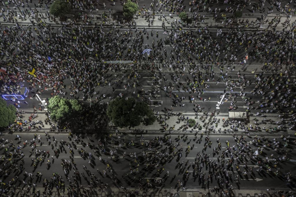Brazilians attend a protest against corruption. Photo EPA/Oliver Weiken